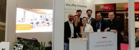 A group of men and women gathered at the Regus Paris Expo